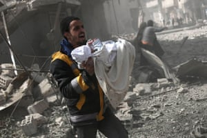 A man carries a baby rescued from the rubble