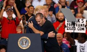 "Donald Trump hugs Gene Huber at a ""Make America Great Again"" rally in Florida."