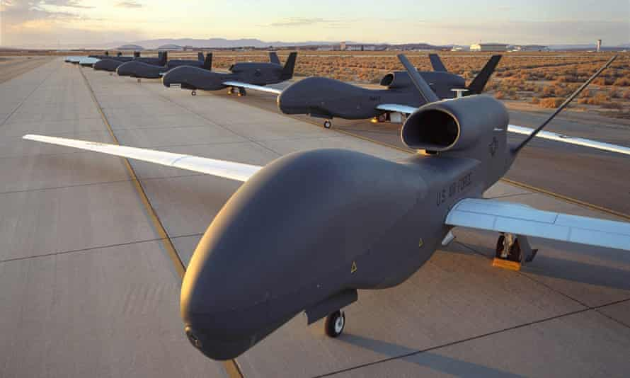 RQ-4 Block 10 Global Hawk unmanned drones are shown at an undisclosed location.