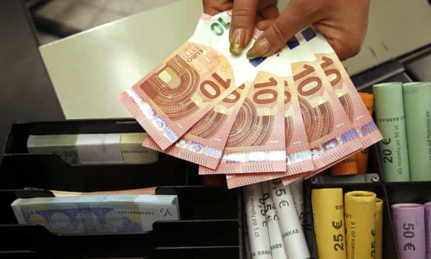 Euro coins and banknotes at a shop in Vilnius, Lithuania.