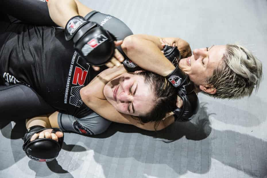 Julia Schaefer (R) and Rebecca Bowman spar during at training session.
