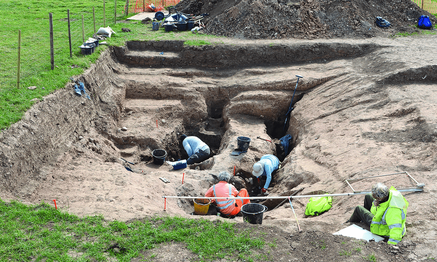 A group of four people working at the archeological site near Loftus