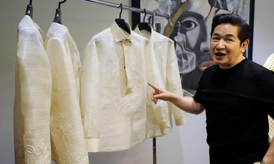 Filipino designer Paul Cabral shows off the 'barong' shirts he has designed for world leaders at this week's Apec summit in Manila.