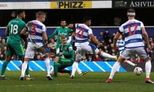 Etienne Capoue watches at his shot gets through a crowded goalmouth for Watford's first goal in the FA Cup fifth round tie against QPR.