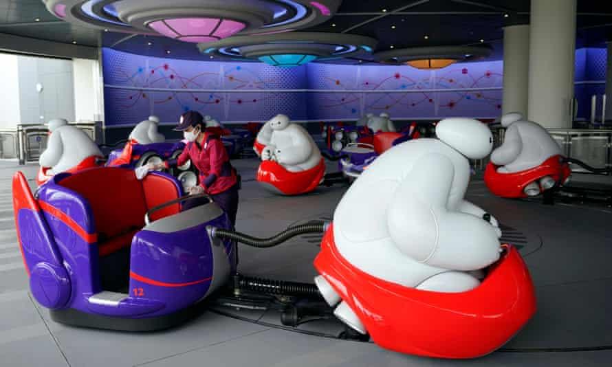 A staff member cleans the new Big Hero 6 ride at Tokyo Disneyland in Japan.