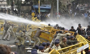 Police use water canon during a protest demanding the resignation of the Hyderabad University vice-chancellor over the suicide of a Dalit scholar Rohit Vemula.