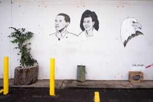 Barack and Michelle Obama protected by an eagle, mural by Sam Phillips. Fair Party Store, 6541 Gratiot Ave, Detroit, 2013
