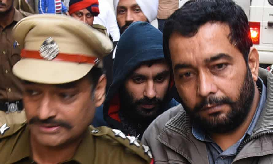 Briton Jagtar Singh Johal (c) being escorted to a court in Ludhiana, Punjab in November 2017
