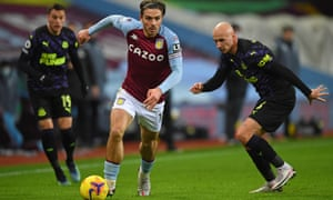 FBL-ENG-PR-ASTON VILLA-NEWCASTLEAston Villa's English midfielder Jack Grealish (C) runs away from Newcastle United's English midfielder Jonjo Shelvey (R) during the English Premier League football match between Aston Villa and Newcastle United at Villa Park in Birmingham, central England on January 23, 2021. (Photo by Gareth Copley / POOL / AFP) / RESTRICTED TO EDITORIAL USE. No use with unauthorized audio, video, data, fixture lists, club/league logos or 'live' services. Online in-match use limited to 120 images. An additional 40 images may be used in extra time. No video emulation. Social media in-match use limited to 120 images. An additional 40 images may be used in extra time. No use in betting publications, games or single club/league/player publications. / (Photo by GARETH COPLEY/POOL/AFP via Getty Images)
