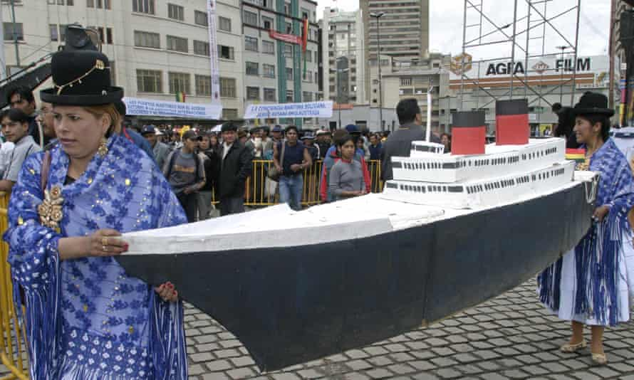 Bolivian indigenous women carry a model boat during the celebrations for the annual 'Sea Day' in La Paz, Bolivia, in 2006.