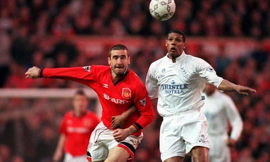 Manchester United's Eric Cantona challenges Leeds's Carlton Palmer for the ball in April 1996.