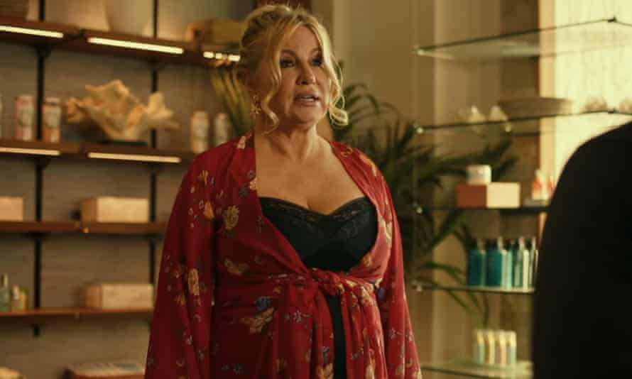Jennifer Coolidge as Tanya, in a dressing gown