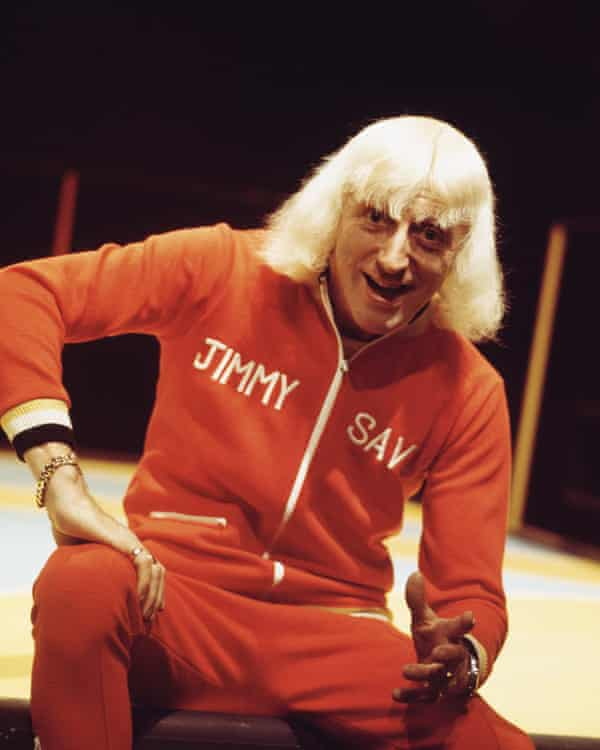 Jimmy Savile presents the BBC Top Of The Pops graphic, circa 1973, in a custom tracksuit.