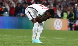 England's Marcus Rashford reacts after missing his penalty.