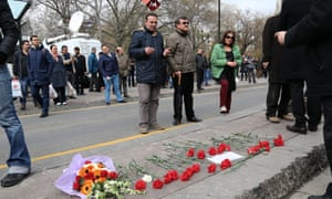 People at the site of Sunday's explosion in Ankara, Turkey.