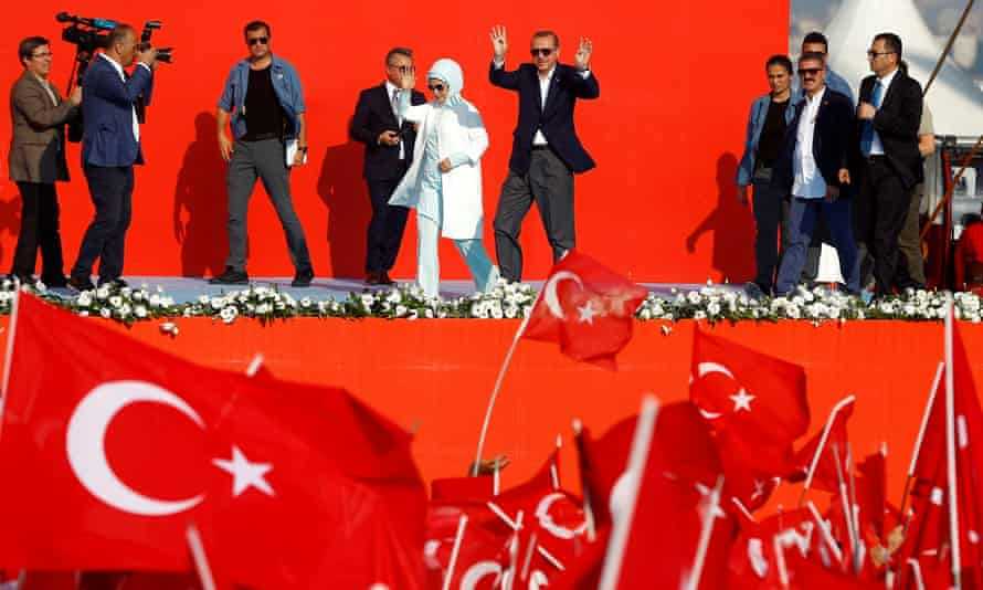 Turkish president Recep Erdoğan and his wife, Emine, attend a rally in Istanbul.