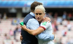 Steph Houghton embraces England head coach, Phil Neville, after the 2-1 victory over Scotland in Nice on Sunday.