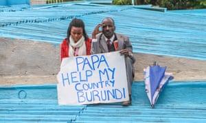 Burundians hold a sign during Pope Francis's visit to Nairobi, Kenya, in November.