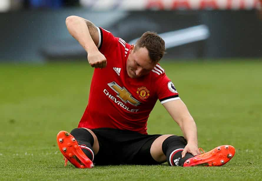 Phil Jones punches the floor in frustration after suffering an injury which turned out to be pivotal in the game.