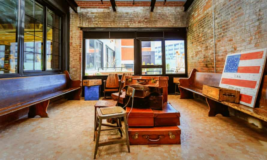 Paper Factory, NYC hotel, with Americana signs and old suitcases in a communal area.