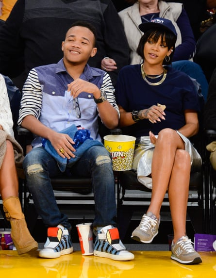 Rihanna, wearing New Balance trainers, and her brother Rajad Fenty