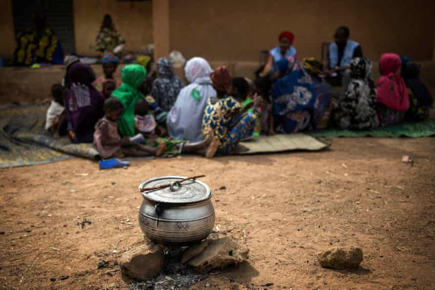 Workers from MINUSMA, the UN mission in Mali, speak with civilians who fled Minima Maoude, a village that was a village that was totally burned down and at least 18 people died.