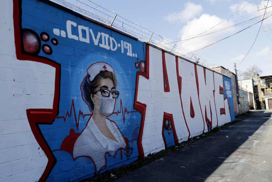 A Covid-19 mural is seen in Chicago Logan Square on 10 April.