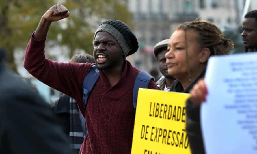 Demonstrators shout slogans and hold placards saying 'Expression of freedom in Angola' in March.