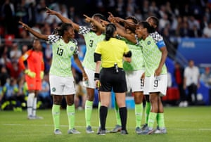 The Nigeria players remonstrate with referee Melissa Borjas.