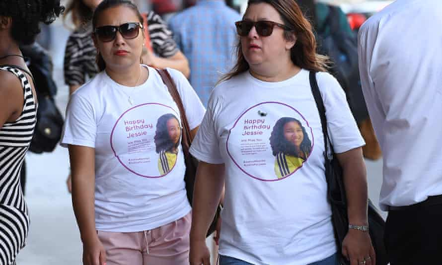 Two women wear tribute shirts to 12-year-old Jessica Urbano outside the meeting, which was the first official meeting between Grenfell survivors and the police and coroner.