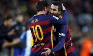 Barcelona's Lionel Messi, left, and debutant Arda Turan