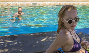 Ralph Fiennes as Harry in A Bigger Splash with Dakota Johnson as his daughter, Penelope