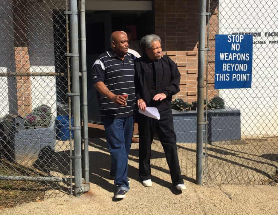 A handout image provided by Squire Patton Boggs and taken by Billy Sothern, the attorney of Albert Woodfox, shows Woodfox, right, being accompanied by his brother Michel Mable, left, as he walks out of the West Feliciana Parish detention center on 19 February 2016.