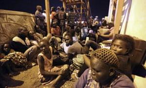 People take shelter near a UN compound in Juba, South Sudan