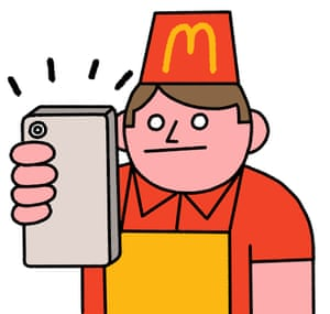 Man in McDonald's uniform taking a selfie with his smartphone
