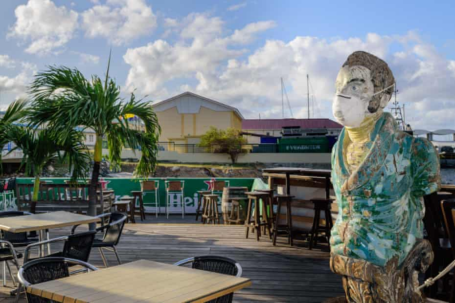 Bar mascot at the Sint Maarten Yacht Club wears a face mask while it is closed due to the Covid-19 pandemic
