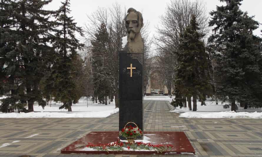 A wooden cross on a statue of Felix Dzerzhinsky