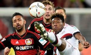 Leverkusen's Karim Bellarabi, left, and Christoph Kramer vie with Bayern's David Alaba.