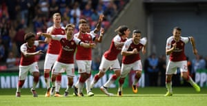 Arsenal players celebrate winning the penalty shoot-out.