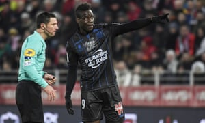 Mario Balotelli of Nice (right),makes his point to the French referee Nicolas Rainville during Saturday's 3-2 defeat to Dijon at the Gaston Gérard Stadium.
