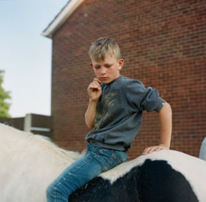 Lewis sits on his horse Henry