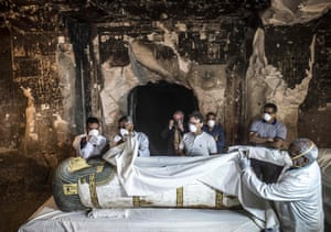 Egypt's antiquities minister Khaled el-Enany and Mostafa Waziri, the secretary general of the supreme council of antiquities, inspect an intact sarcophagus during its opening.