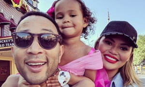 Family man: John Legend in an Instagram post with his daughter Luna and wife Chrissy Teigen.