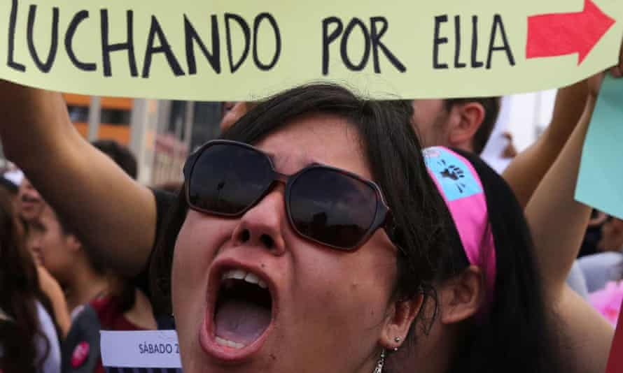 A protest in Lima over violence against women. The sign reads: 'Fighting for her.' Nearly 42,000 girls and women have 'disappeared' in Peru since 2018.