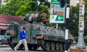 An armoured personnel carrier patrols the streets of Harare after the army takeover of the capital.