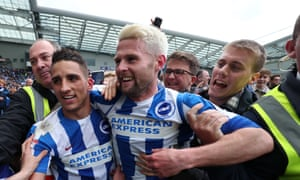 Oliver Norwood (right) on the field following Brighton's promotion in 2017.