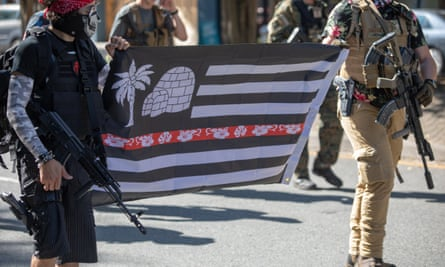 Armed Boogaloo protesters during a demonstration against new firearm restrictions in Richmond, Virginia, 18 August 2020.