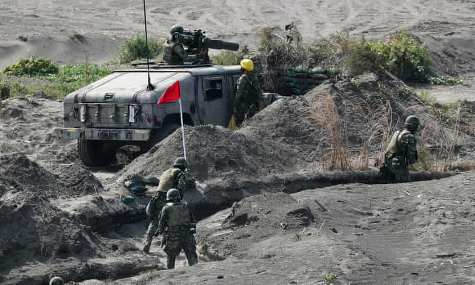 Taiwanese military personnel and vehicle