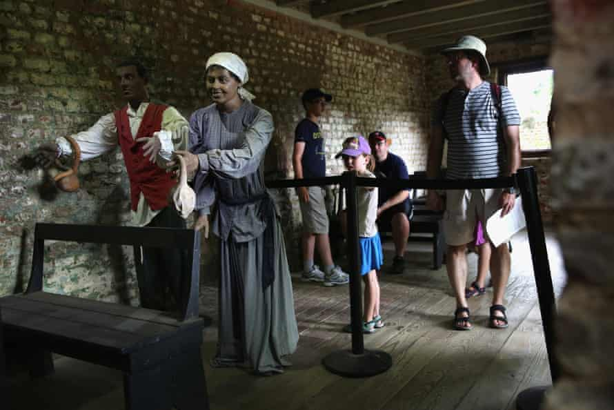 Tourists look over mannequins in the former slave quarters of the Boone Hall Plantation in Mount Pleasant, South Carolina.