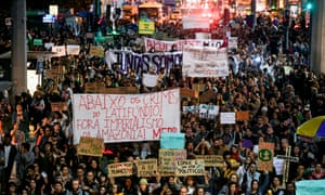 Protesters march in Rio on Friday against the government of Brazilian president Jair Bolsonaro over the fires in the Amazon rainforest.